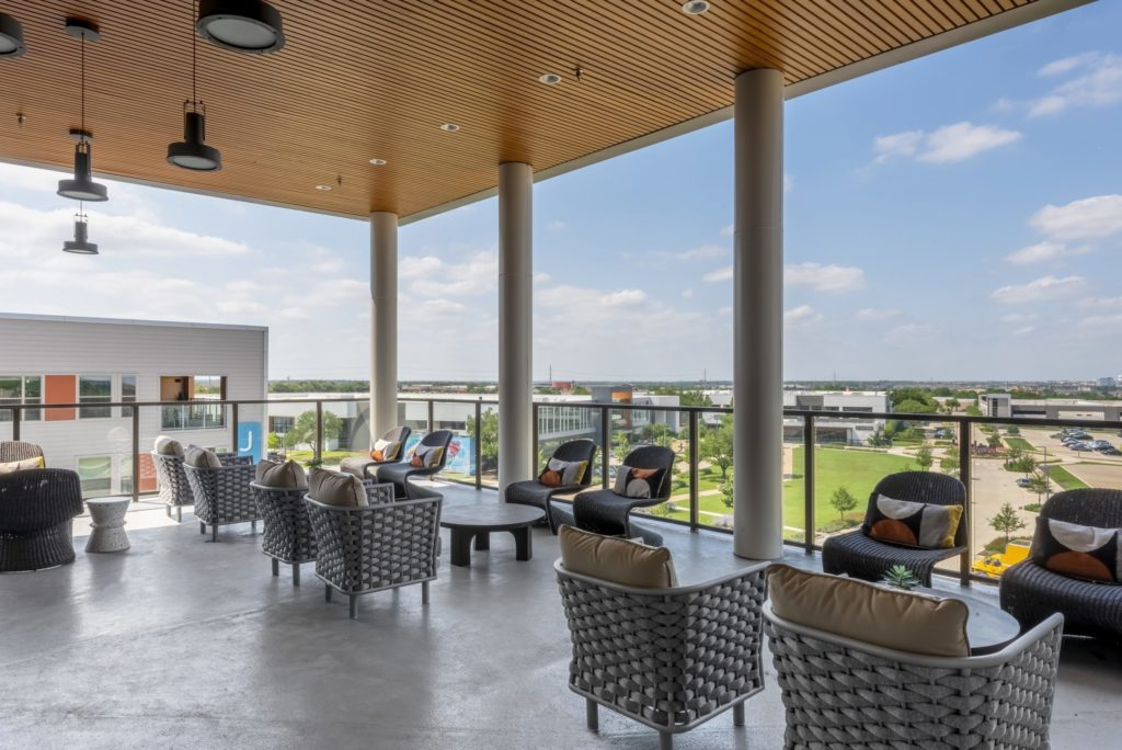 Take in the nighttime scenery from the sky deck/club room with TVs, half kitchen, coffee bar, and outdoor deck - Do Your Weekends Right